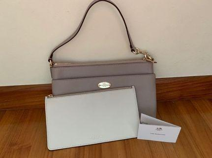 🚚 Coach small handbag / wristlet + pouch - 2 in 1 BNIB