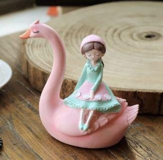 Girl on pink swan figurine