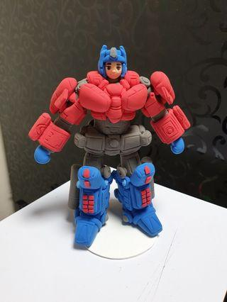Customised cake topper figurine - Optimus Prime made of air dry clay