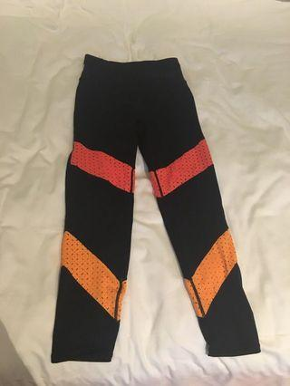 Cotton On Black leggings with coral red and coral orange sections