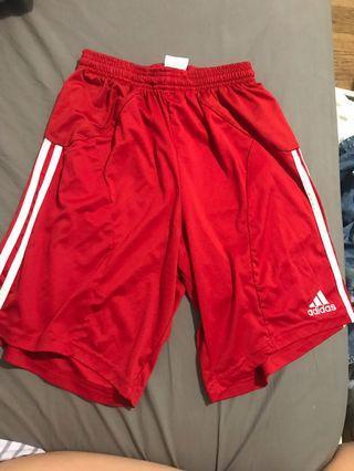 Red adidas basketball shorts