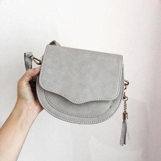 New grey tassel sling bag