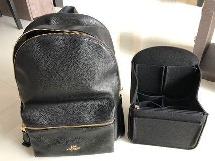 Black Coach pebble leather backpack