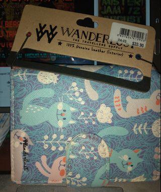 Wanderlust leather wallet cat design