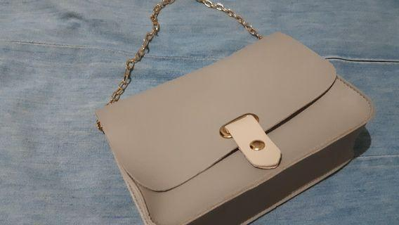Beige clutch with detachable gold chain strap
