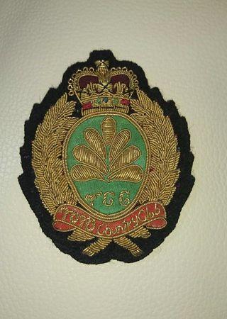 Vintage gold sewn blazer pocket badge