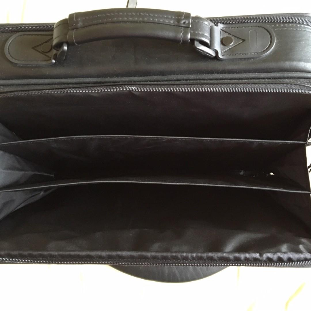 """BELKIN"" LEATHER OFFICIAL BUSINESS BAG.  L 15-1/2"" x W 4"" x H 12"".  BOTH FRONT & BACK HAVE ZIPPERS."