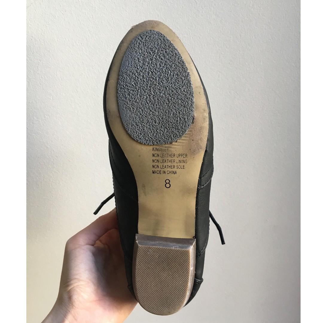 Black formal flats in good condition with extra grip pads