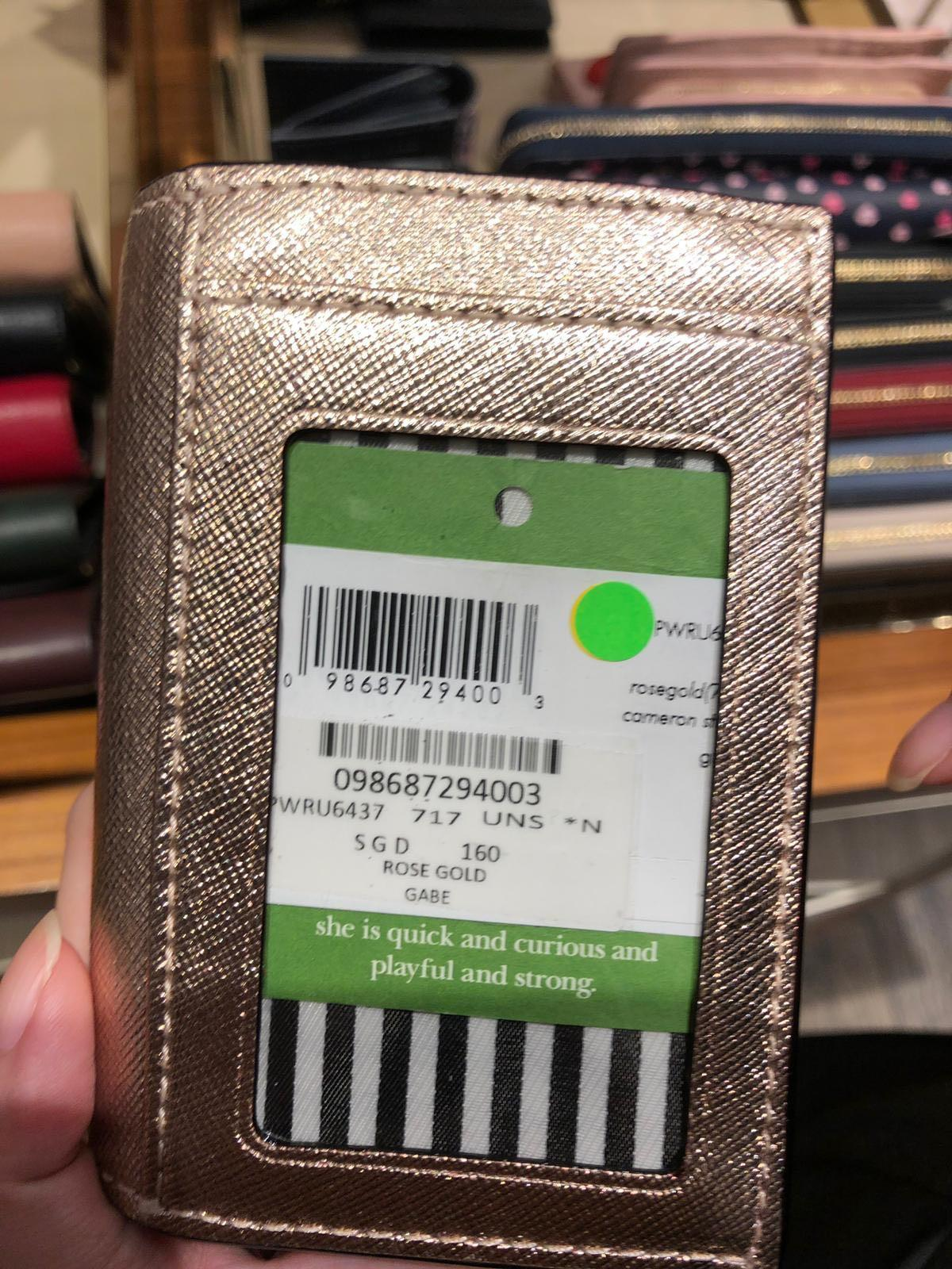 Kate Spade compact wallet in Rose Gold