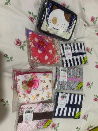 Naraya tissue holders and pouches