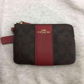 🚚 Coach Leather Coated Canvas Pouch