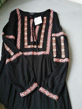 Black dress with embroidered accent
