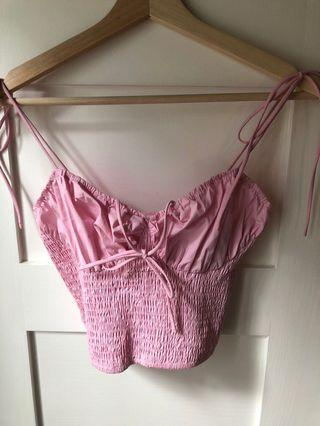 Pink, accordion bustier style crop top