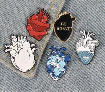 Heart enamel pins