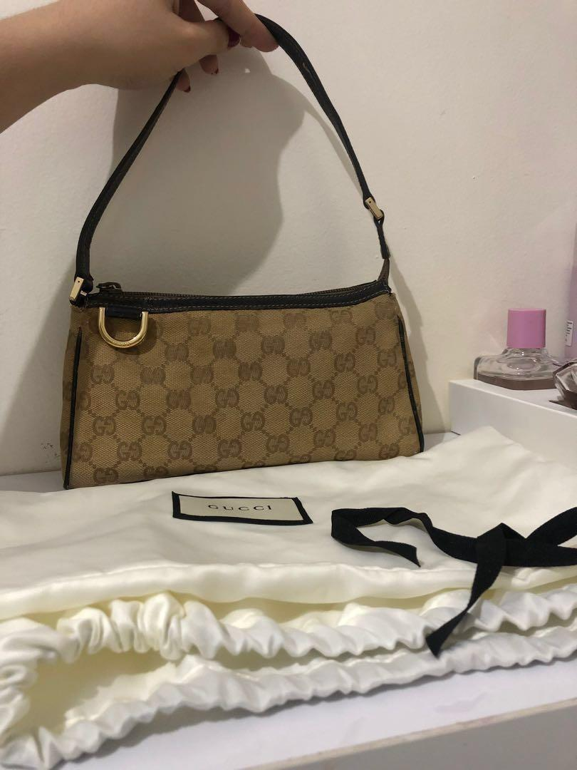 Good deal! Authentic Gucci D Ring Pochette