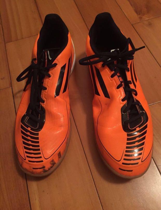 Orange adidas adiprene F50 sports shoes