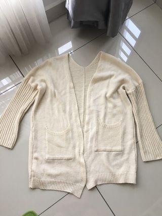 Beige oversized knitting cardigan with pocket