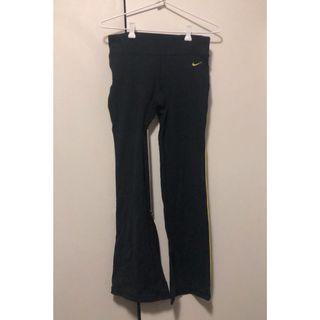dri-fit flared track pants with yellow stripe detail on the side