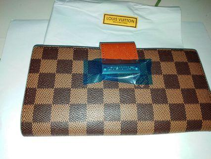 COACH and LV Wallet