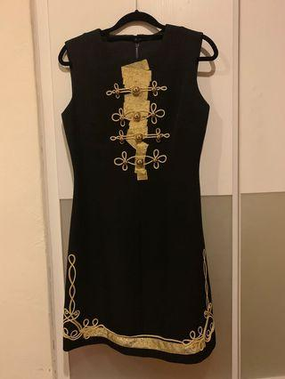 Military style black dress with gold trimming