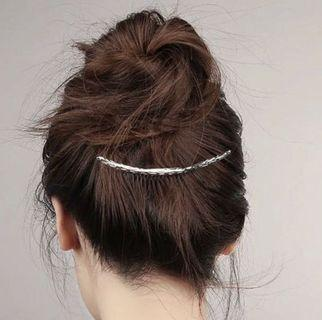 Silver curved hair comb