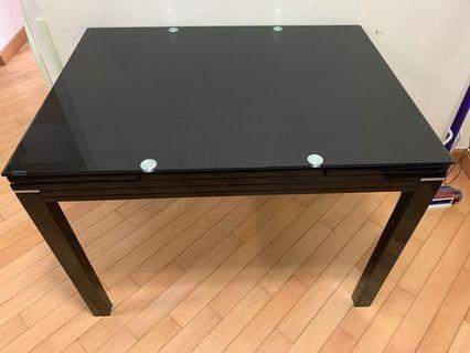 Black dining table, extendable sides and tempered glass top