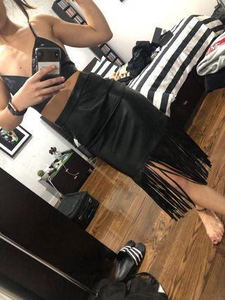 Black leather look skirt with fringe