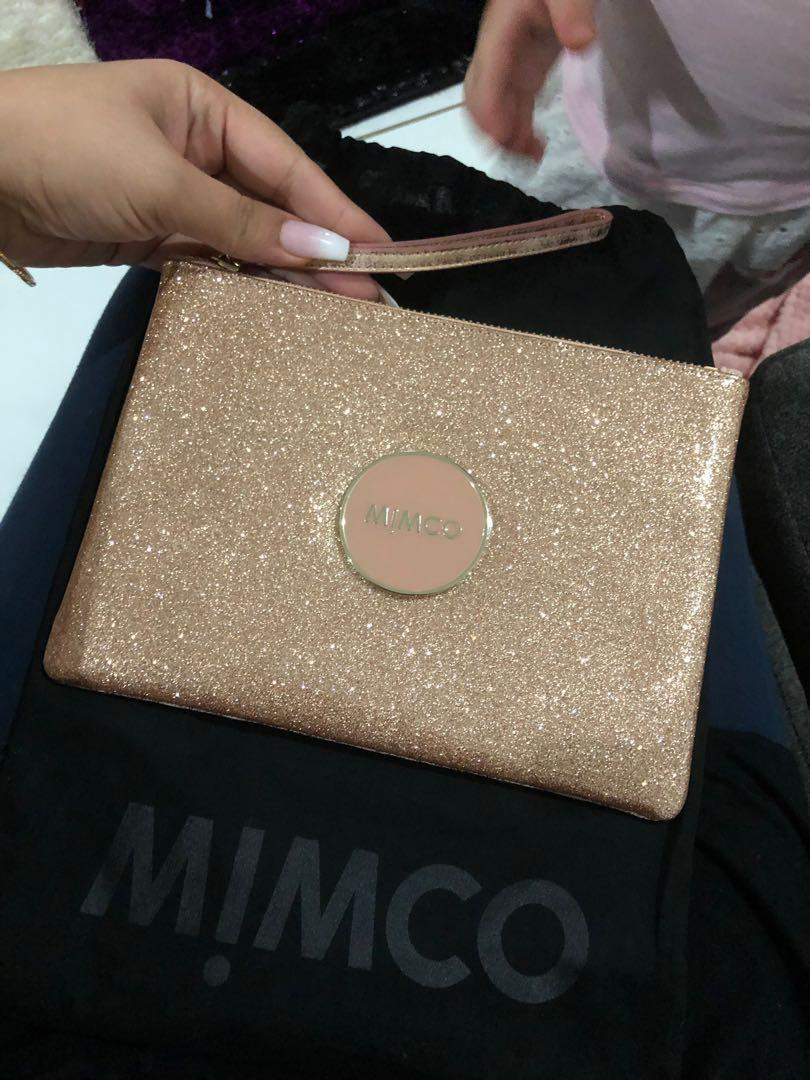 Mimco pouch and flip cover