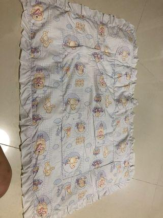Baby cot bedding layer