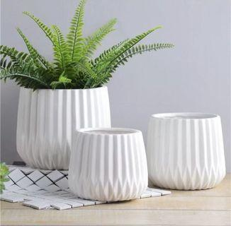 Stylist ceramic planter with drainage hole