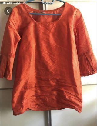 Dark orange top