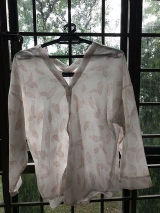 White shirt with red leaves