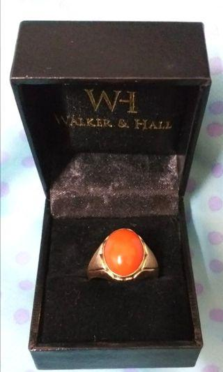 A vintage 14k solie rose gold with coral ring.