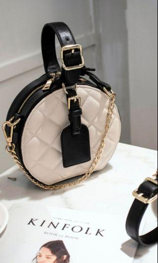 Round quilted sling bag