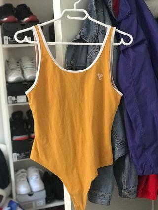 tna yellow bodysuit