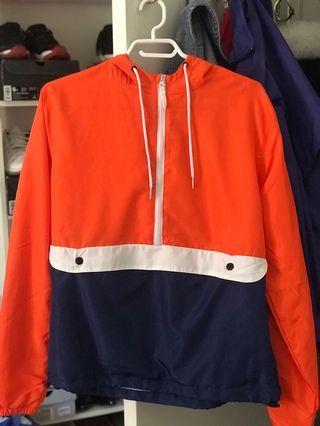 orange, white, navy windbreaker