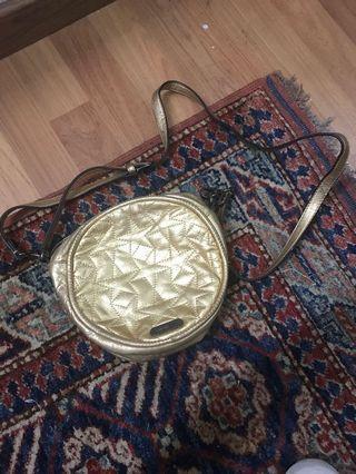 Mimco gold colour circular leather sling bag