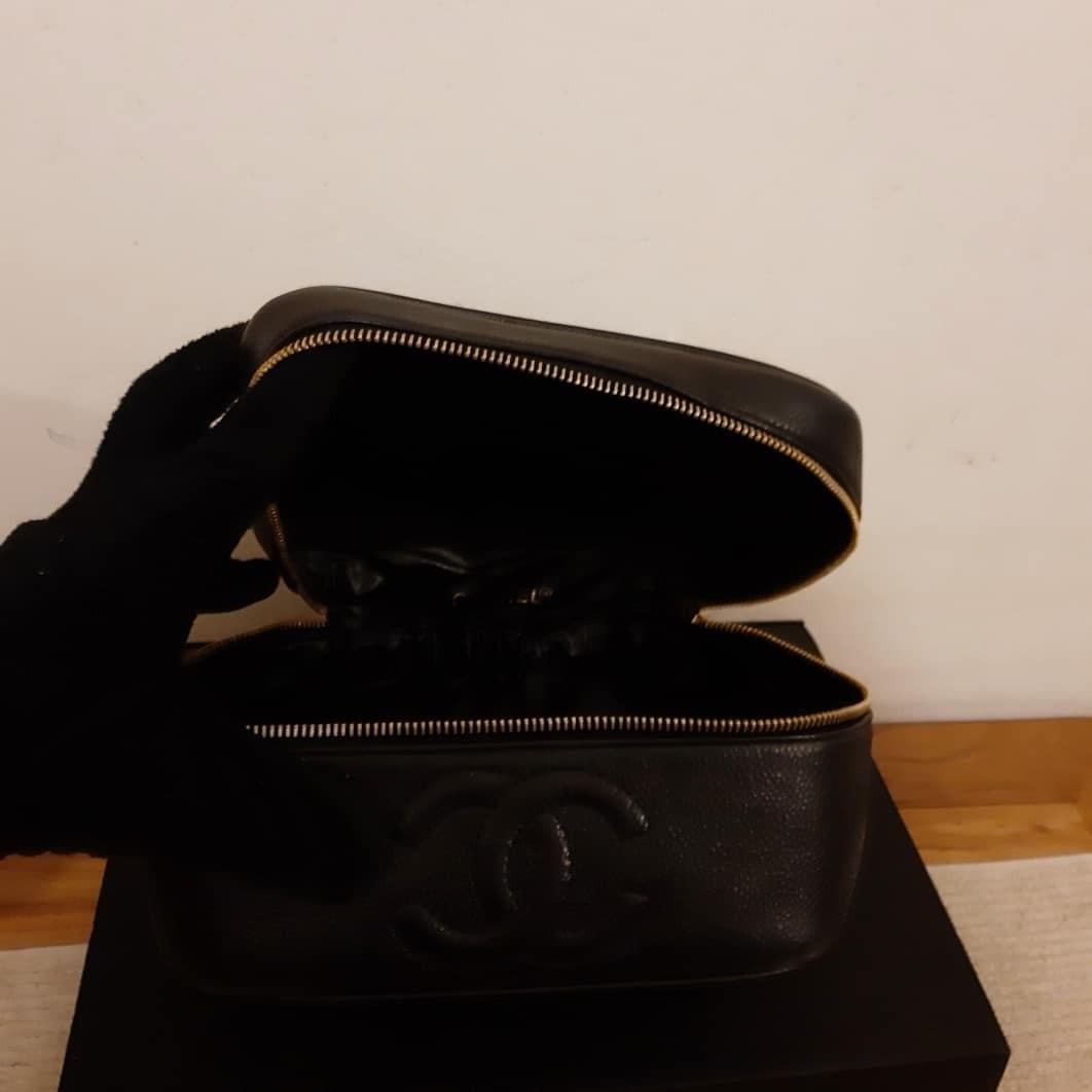 AUTHENTIC CHANEL VANITY BAG - BLACK CAVIAR LEATHER - GOLD HARDWARE - CLEAN INTERIOR , HOLOGRAM STICKER INTACT- COMES WITH AUTHENTICITY CARD - SOLID SHAPE STRUCTURE - COMES WITH EXTRA LONG CHAIN STRAP FOR CROSSBODY SLING