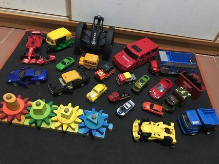 Toy cars and wooden rotating shape wheels