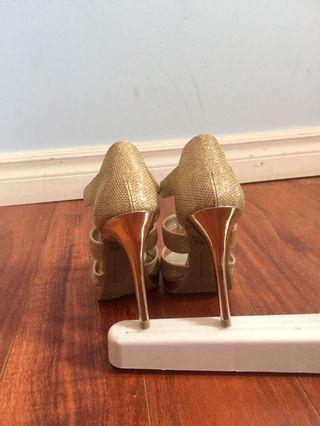 Gold size 6.  3.5 inches heels