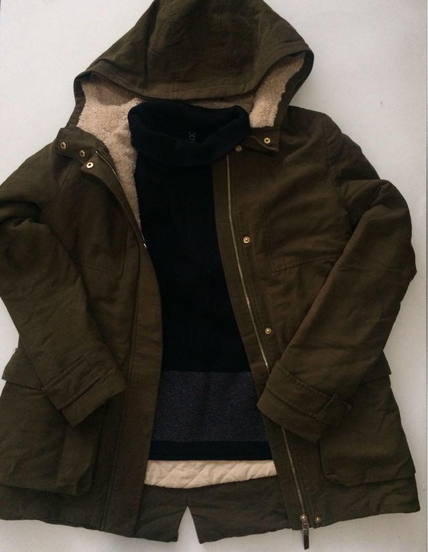 Khaki winter coat jacket & black turtle neck jumper