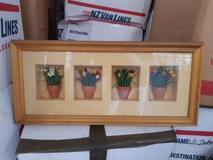 Miniature potted plants in a picture frame