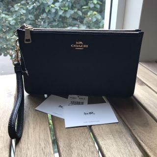 Authentic COACH leather clutch w tags