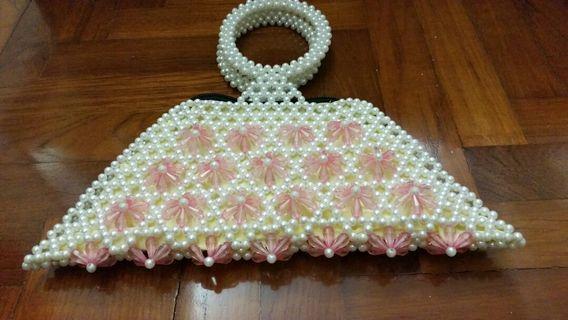 Uniquely shaped handmade beaded bag