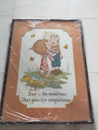 "Vintage Cross stitch framed titled ""Love is the sweetness that gives life completeness."""
