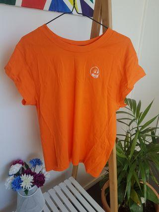 Fluro orange sustainable tee by Cheap Monday