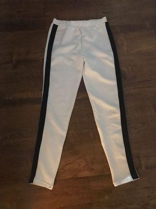 White pants with black list