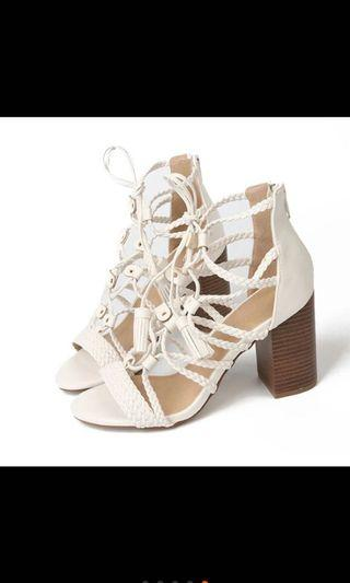 🚚 BN white high heeled sandals with a criss crossed front
