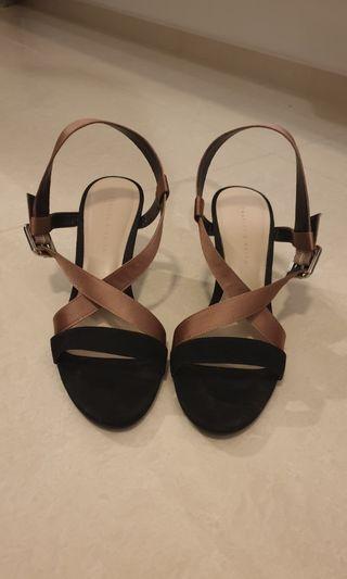 Pale pink and black strap heels