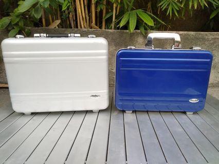Attache case briefcase zero halliburton plastic bag silver and blue